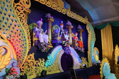 Divine darshan of Lord Shree Swaminarayan, Jeevanpran Shree Abji Bapashree and Jeevanpran Shree Muktajeevan Swamibapa seated on the wonderfully decorated stage