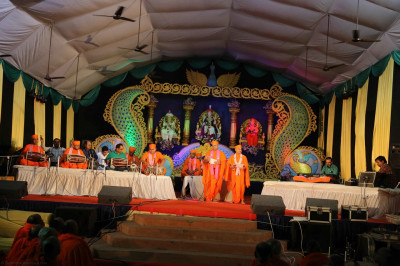 Sants, talented disciples, and artists perform traditional and modern devotional songs accompanied by melodious music to please Lord Shree Swaminarayanbapa Swamibapa
