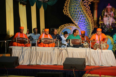 Sants, talented disciples, and artists perform traditional and modern devotional songs accompanied by melodious music and various drums to please Lord Shree Swaminarayanbapa Swamibapa