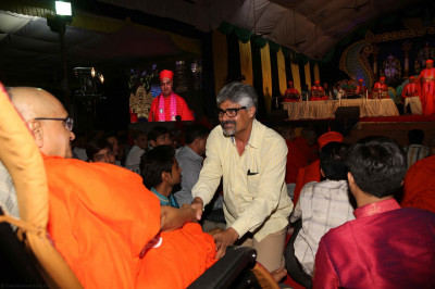 His Divine Holiness Acharya Swamishree blesses a guest