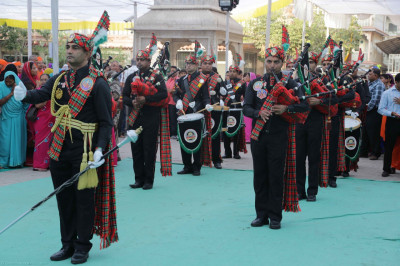 H. H. Swamibapa Pipe Band perform leading the procession