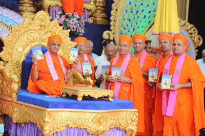 His Divine Holiness Acharya Swamishree presents a new release of Sanskar Deepika Part 2 to Sants and disciples