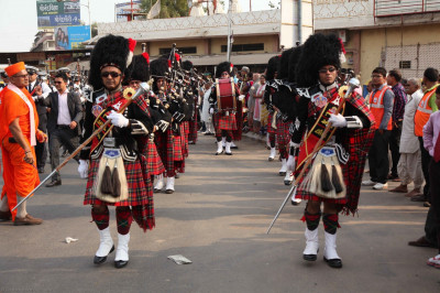 Shree Muktajeevan Pipe Band perform throughout the procession