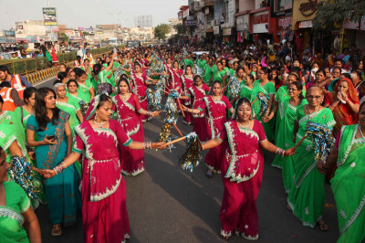 Disciples perform energetic dances through the streets