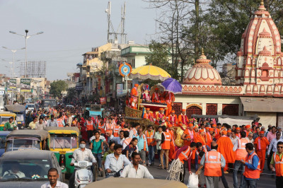 The procession proceeds through the main highway