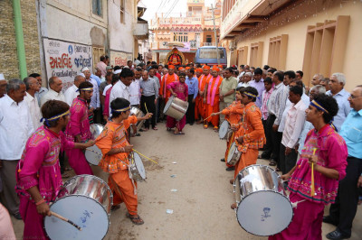 A drum band performs during the procession