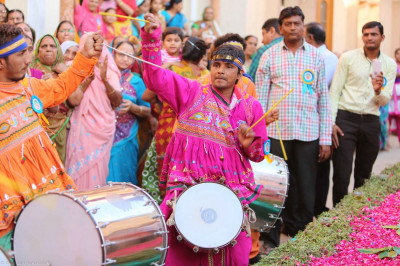 Dhol players perform during the event