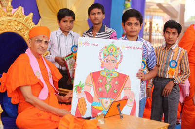 A young disciple presents a hand painting of Lord Swaminarayan