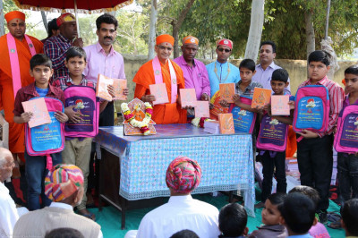 Acharya Swamishree donates school bags to the children