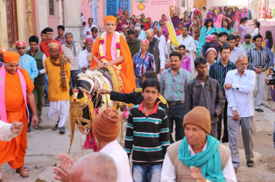Procession passes through the narrow streets of the town