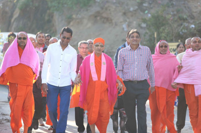 Acharya Swamishree walks towards Lake Nakki