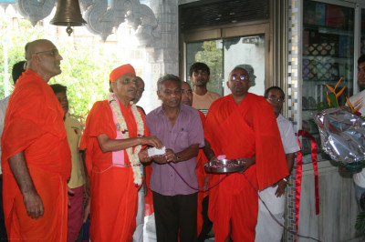 His Divine Holiness Acharya Swamishree officially switches on the manidr ceiling lights