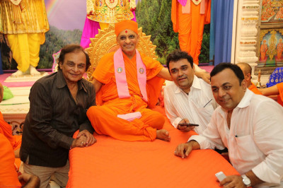 His Divine Holiness Acharya Swamishree blesses the performers