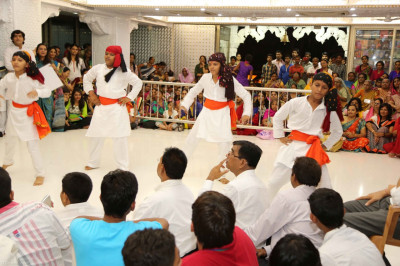 Young disciples perform a devotional dance