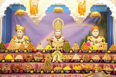 Lord Shree Swaminarayan, Jeevanpran Shree Abji Bapashree and Jeevanpran Shree Muktajeevan Swamibapa dine on delicious annakut