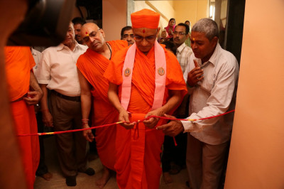Acharya Swamishree Maharaj consecrates one of the guest rooms