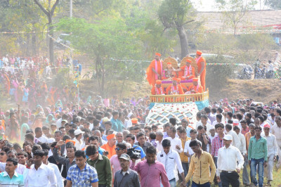 Thousands of disciples and local residents take part in the procession