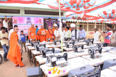 His Divine Holiness Acharya Swamishree donates many sewing machines that the local residents can use to earn a good livelihood