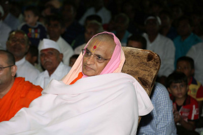 Acharya Swamishree Maharaj watches the performances