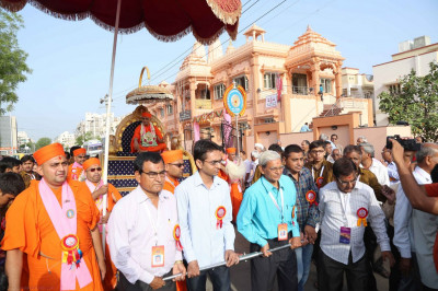 Acharya Swamishree's chariot is pulled by disciples during a procession from Ranip mandir