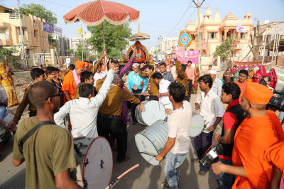 Dhol players perform during the procession