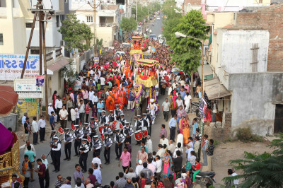 The procession continues through the streets of Ranip