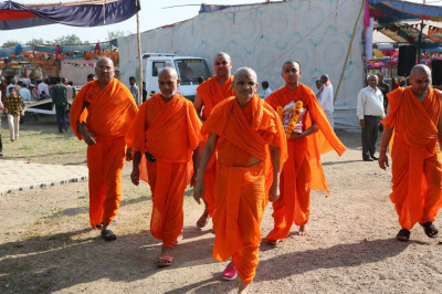 Acharya Swamishree and Sants go to the festival kitchen area