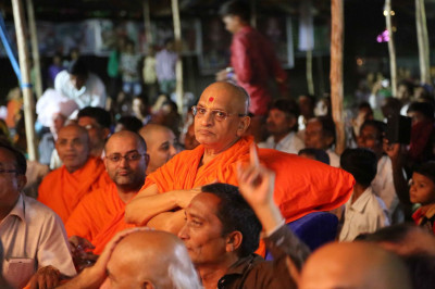 Acharya Swamishree Maharaj and Sants watch the performances