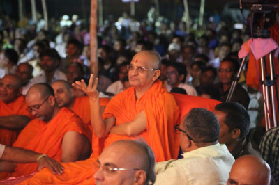 Acharya Swamishree Maharaj watches the dance performance