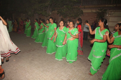 Ladies take part in the raas