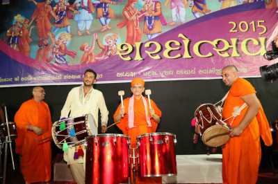 Acharya Swamishree Maharaj playing the drums
