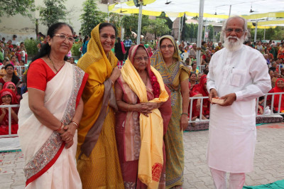 Shardaben Vasantbhai Patel is honoured with a shawl
