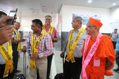 Day 1 - Acharya Swamishree, sants, and disciples arrive in Lucknow, Uttar Pradesh at Chaudhary Charan Singh International Airport