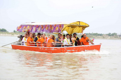 Sants and disciples on a boat in Saryu River