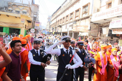 Swamibapa Swamishree Music Band performs during a grand procession in the city of Varanasi