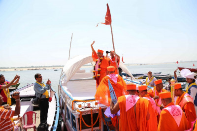 Acharya Swamishree on board a boat on River Jamuna