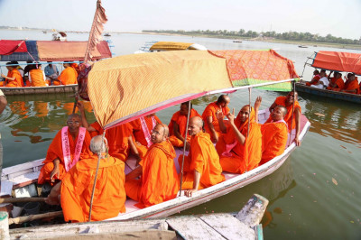 Sants and disciples on board boat for a trip on Yanuma River