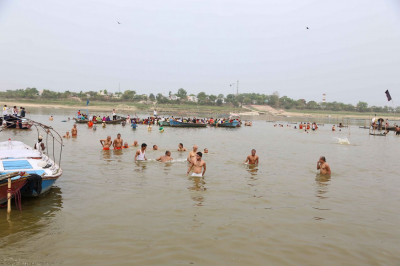 Sants and disciples bathe in the River Yamuna