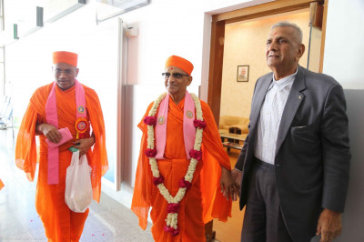 Acharya Swamishree arrives at Ahmedabad Airport in the afternoon