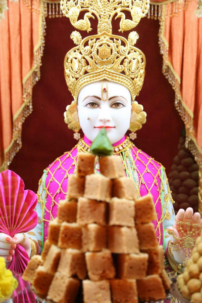 Lord Shree Swaminarayan dines on the annakut