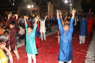 Young disciples perform a welcome dance