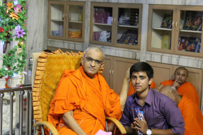 His Divine Holiness Acharya Swamishree blesses the young disciple