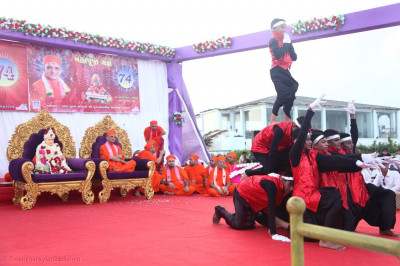 Young disciples perform a dance to the tune of the new theme song of Shree Muktajeevan Swamibapa Smruti Mandir Rajat Mahotsav