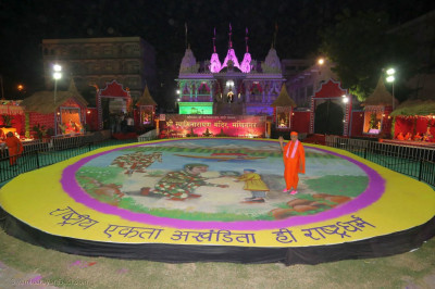 Acharya Swamishree Maharaj gives darshan at the huge rangoli