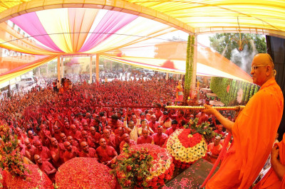 His Divine Holiness Acharya Swamishree showers all in coloured water