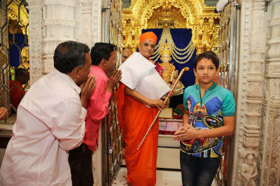 Disciples offer a golden chhadi for Lord Shree Swaminarayan