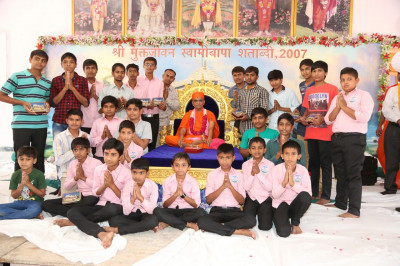 His Divine Holiness Acharya Swamishree gives pooja to young disciples