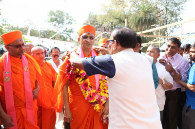 A garland of fresh flowers is offered to His Divine Holiness Acharya Swamishree