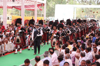 Shree Muktajeevan Pipe Band London and Maninagar perform escorting honoured guests to the stage