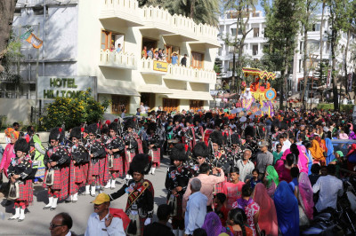 Shree Muktajeevan Swamibapa Pipe Band London leads the procession through the streets of Mount Abu as local residents enjoy the performances